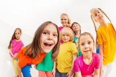 Children`s sports team with young female coach royalty free stock photo