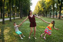 Children`s struggle for parental love on nature. Children`s struggle for parental love on the nature. Jealousy and confrontation. Family conflict stock photos