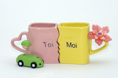 Children's stuff. Mugs, small car, small flower Royalty Free Stock Photography