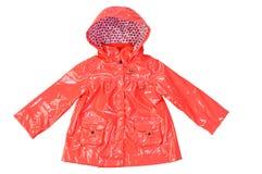 Children's stylish fashionable lacquered orange jacket. For the girl Royalty Free Stock Images