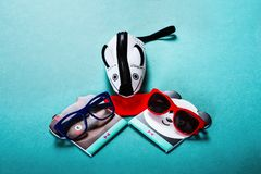 Children`s sunglasses and a cover in the form of a mouse on a blue background stock photos