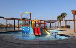 Children's swimming pool with slides for entertainment Royalty Free Stock Images