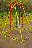 Children's swing. Expecting children on a platform, around autumn Royalty Free Stock Images