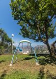 Children`s swing in the garden  with the Gulf of Naples and Vesuvius in the background.  Stock Images