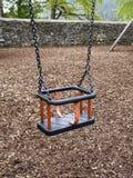 Children`s swing set. Empty children`s swing set concept royalty free stock photo