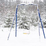 Children's swing in the snow Royalty Free Stock Images