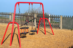 Children's swings in a playground. Royalty Free Stock Images