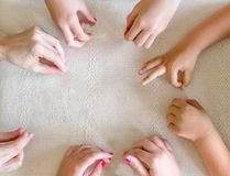 Children`s and Teacher`s hands together on the table stock images
