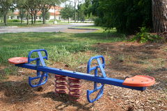 Children's Teeter Totter. Teeter Totter in playground stock photography