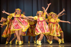 Children's theatrical performance of dance group in national costumes Stock Photography