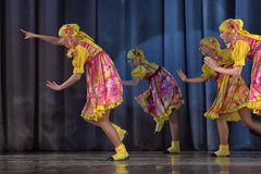 Children's theatrical performance of dance group in national costumes Stock Photos