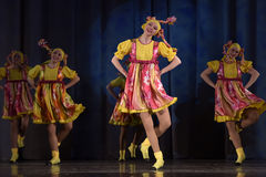 Children's theatrical performance of dance group in national costumes Stock Photo