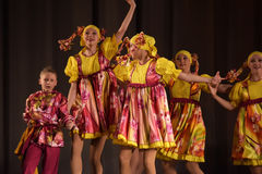 Children's theatrical performance of dance group in national costumes Royalty Free Stock Photo