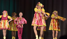 Children's theatrical performance of dance group in national costumes Royalty Free Stock Image