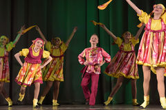 Children's theatrical performance of dance group in national costumes Royalty Free Stock Photos