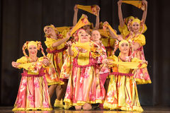 Children's theatrical performance of dance group in national costumes Royalty Free Stock Photography