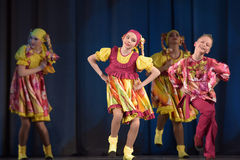 Children's theatrical performance of dance group in national costumes Royalty Free Stock Images