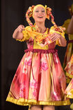 Children's theatrical performance of dance group in national costumes Stock Images
