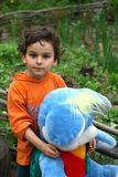 Children's toy. The child with a toy in a garden Stock Images