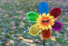 Children`s toy air mill with colorful petals royalty free stock photo