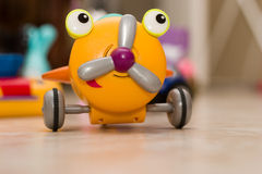Children's toy airplane. In the background of children's room Royalty Free Stock Photo