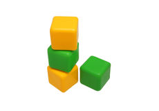 Children's toy blocks set against each other. Yellow and green Stock Photo