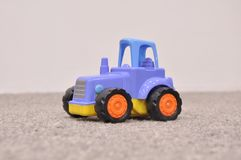 Children`s toy, blue tractor stock images