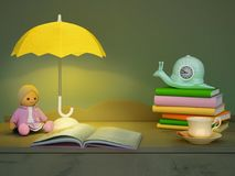 Children`s toy, books, clock, the lamp are located on a table. Stock Images