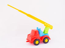 Children`s toy car. On a white background Royalty Free Stock Photography