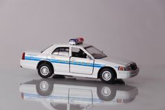 Children`s toy car on white background with reflection. Close up stock photos
