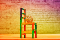 Children's toy chair and wicker ball Royalty Free Stock Photography