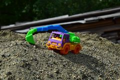 Children`s toy excavator royalty free stock photography