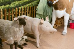 children`s toy farm. Toy sheep, pig, cow large on a farm.