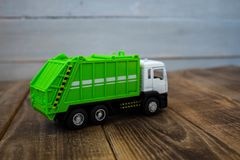Children`s toy green garbage truck royalty free stock photos