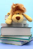Children's toy lies on the combined books. Books for children combined against each other with a children's toy Royalty Free Stock Photo