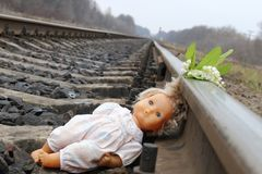 Children`s toy lies on the train rails. stock image