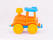 Children`s toy locomotive. On a white background Royalty Free Stock Photo
