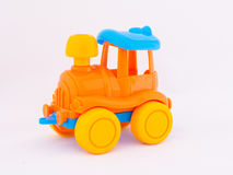 Children`s toy locomotive. On a white background Royalty Free Stock Image