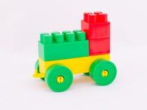 Children`s toy machine constructor. Designer children`s toy machine on a white background Stock Images