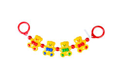 Children's toy rattle, colored garland with yellow bears on a wh. Ite Royalty Free Stock Images