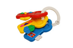 Children's toy rattle with three keys. Yellow, blue, red. Plastic Royalty Free Stock Photos