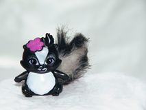 Children`s toy - skunk with bow royalty free stock photos
