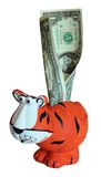 Children's toy tiger moneybox with dollars Royalty Free Stock Photography