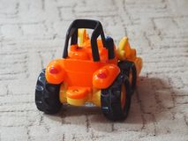 Children`s toy tractor. Rear view stock photo