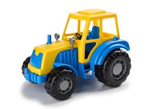 Children`s toy tractor on a white. stock photo