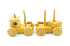 Children's toy a train. Train - children wooden toy isolated on a white background Stock Images