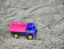 Children`s toy truck car on playground, industrail symbols Stock Photos