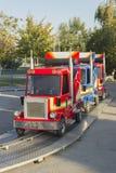 Children's toy truck. Train with children vans coaster royalty free stock image