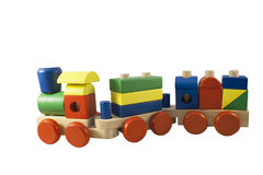 Children's toy. Wooden train with wagons. On a white background Royalty Free Stock Photo