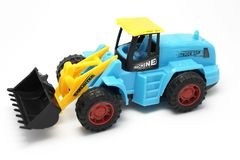 Child toy, tractor, on white background. Children`s toy, yellow-blue tractor with bucket, on white background, car royalty free stock photos